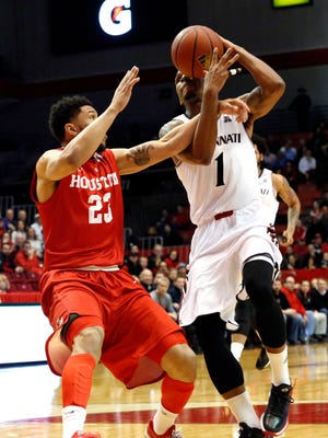 Houston Cougars guard Eric Weary Jr. (23) fouls Cincinnati Bearcats guard Deshaun Morman (1) during the first half at Fifth Third Arena.