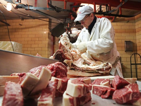 Kent Wiese, processes beef and cuts steaks at Amend Packing Co. in this file photo from 2015. The company will close Friday after 149 years in business.
