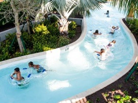 People cool off while drifting in the lazy river at the Hyatt Regency Coconut Point in south Lee County during a family day for staff on Sunday. Employees of the Hyatt Regency Coconut Point Resort & Spa, along with their families, got to try out the resort's new Lazy River water slides on Sunday, before the Nov. 18 grand opening for this $7.1 million water feature.