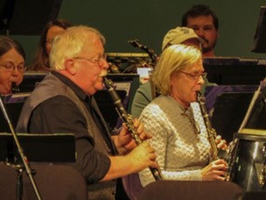Ken McFarlan, left, performs at a recent concert.