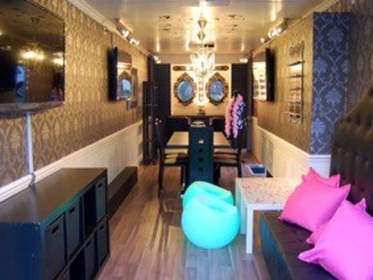 The Rockin' Glamour Bus is a rolling salon that does hair, manicures and pedicures for a birthday party.