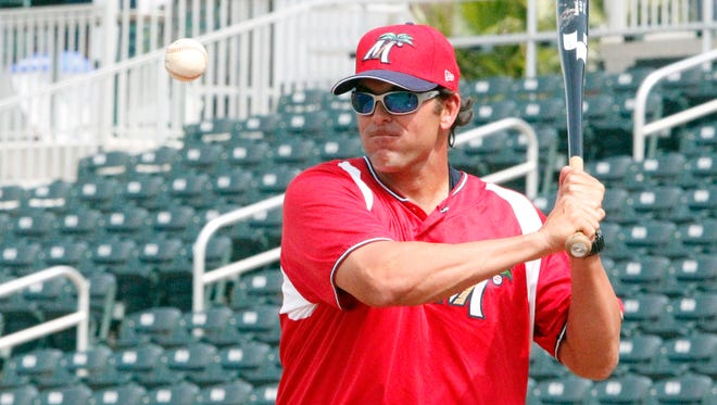 Fort Myers Miracle manager Doug Mientkiewicz goes through infield drills during practice at Hammond Stadium on Wednesday, April 3, 2013.
