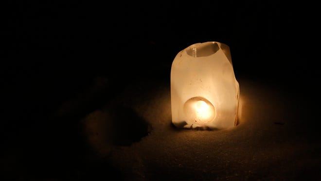 Candles in milk cartons lined the trails on Feb. 4, 2017, in Two Rivers, Wis., during a candlelight hike.