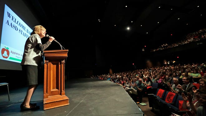 Supt. Judy Baseman welcomes back staff members during the Appleton Area School District's annual all-staff convocation Tuesday at Appleton West High School.