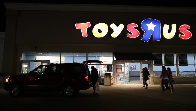 Customers enter Toys R Us during Black Friday.