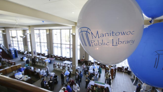 Balloon decorate the balcony of the Manitowoc Public Library during the grand re-opening of Thursdays ribbon cutting Thursday, Feb. 15, 2018, in Manitowoc, Wis.