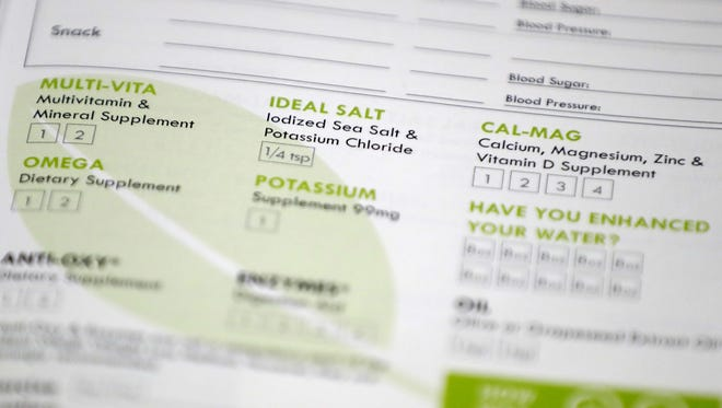 A page from a food journal used in the Ideal Weigh weight-loss program is shown at the Prevea Rejuvenate clinic in Ashwaubenon.