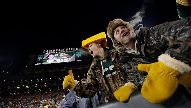 Green Bay Packers fans cheer at Lambeau Field.  Dan Powers/USA TODAY NETWORK-Wisconsin Green Bay Packers fans cheer at Lambeau Field.