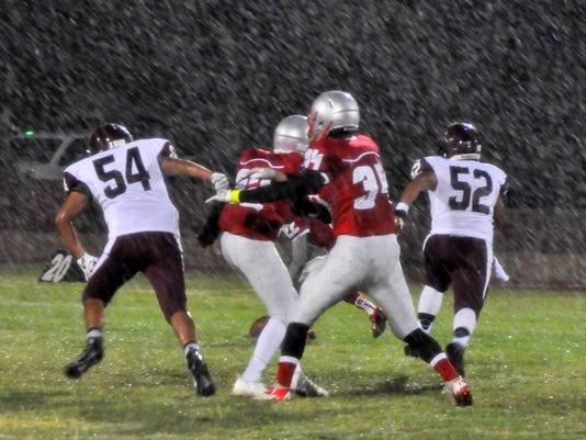 players-in-rain