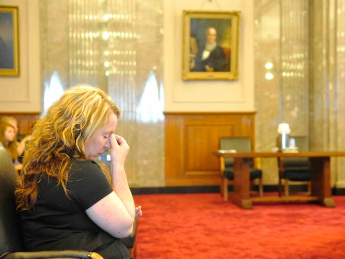 Casey Wilson, wife, of Cyrus Wilson, listens at a Court of Criminal Appeals hearing in Nashville, May 13, 2014, for her husband Cyrus Wilson, who was convicted of murder in 1994 and sentenced to life in prison.