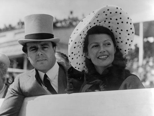 Prince Aly Khan at Epsom races with his wife, Hollywood