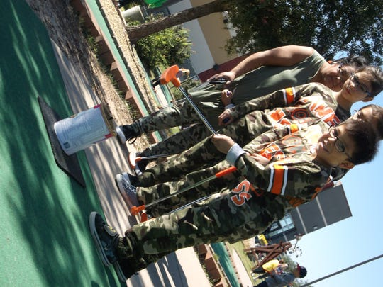 Team Marines at the ninth annual Putt Fore Children Miniature Golf Tournament.