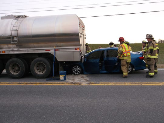 A car crashed into the rear of a milk tanker truck