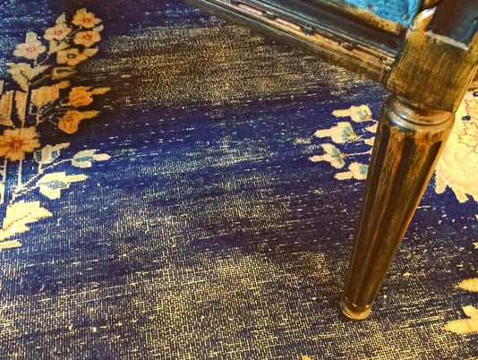 Detail of a vintage style furniture and carpet