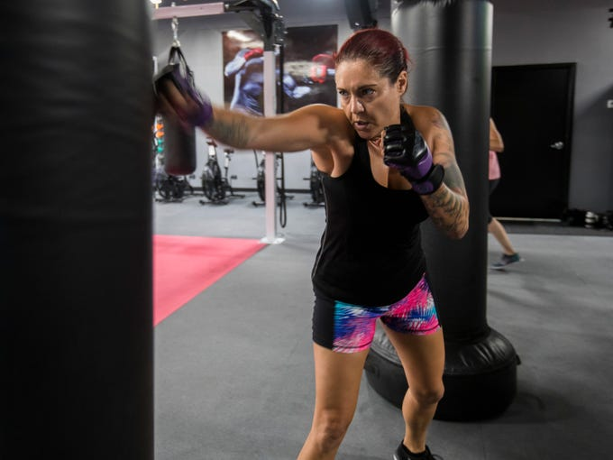 Alexis Arnone works with the heavy bag Tuesday morning