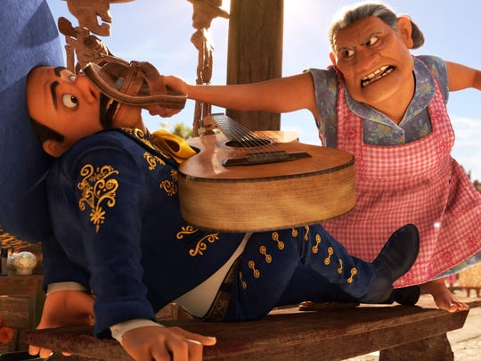 Miguel's grandmother Abuelita (Renée Victor) wields a mean flip-flop in 'Coco.'