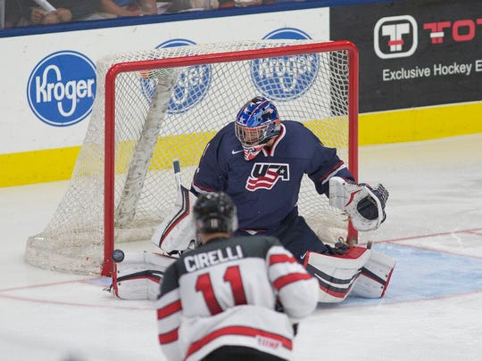 Turning aside this shot from Canada's Anthony Cirelli (11) during the 2016 showcase is Team USA goalie Tyler Parsons.