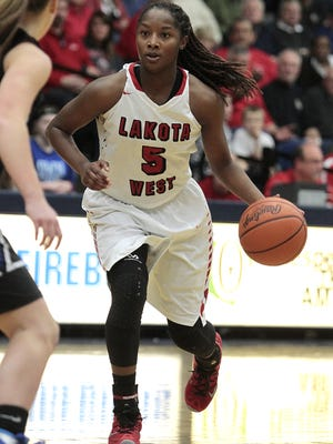 Nia Staples of Lakota West drives the lane against Springboro.  Lakota West takes on Springboro in the Region 4 semi-finals at Kettering Fairmont High School Wednesday, March 2nd, 2016.