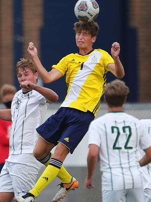 Copley's Colin Link heads the ball over a host of Medina players during the first half of a boys soccer match on Wednesday, Sept. 2, 2020, in Copley, Ohio.