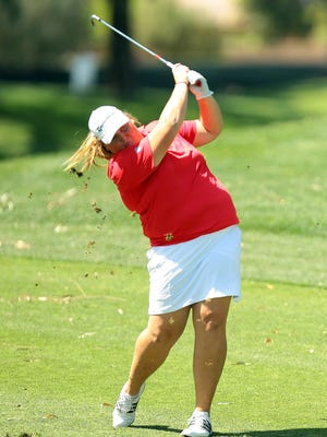 Haley Moore, an Escondido teenager, hits a shot from the fairway on the par 5 ninth hole while playing in the ANA Inspiration on Thursday at Mission Hills Country Club in Rancho Mirage. Moore shot par on the hole and finished her round at one over, 73.