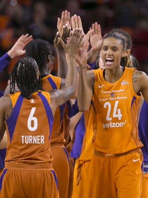 Phoenix Mercury DeWanna Bonner high-fives her teammates after beating the Dallas Wings during round one of the WNBA Playoffs on Aug. 21, 2018, at Wells Fargo Arena in Tempe, Ariz.