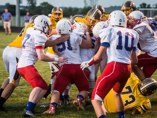 Monroe Central makes a push for the end zone against