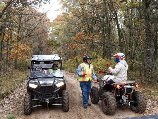 An ATV club member gives directions during a trail ride following a meeting on proposed trail extensions near Camp Ripley and Little Falls on Friday, Oct. 7, on an ATV trail near Randall.