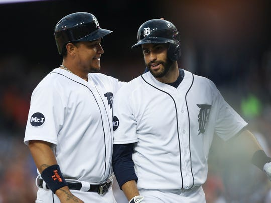 Tigers first baseman Miguel Cabrera congratulates rightfielder