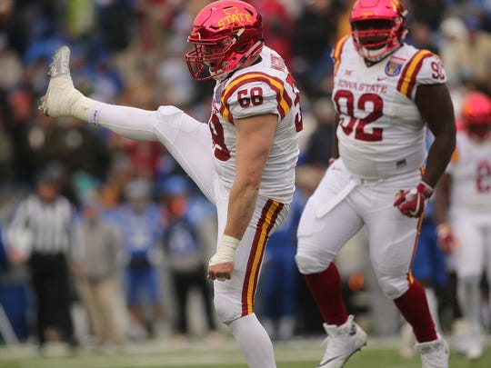 Iowa State Cyclones defensive end J.D. Waggoner (58) celebrates sacking Memphis Tigers quarterback Riley Ferguson (4) during the first half of the  AutoZone Liberty Bowl Saturday, Dec. 30, 2017, in Memphis, Tennessee. ISU lead Memphis at the half, 14-10.