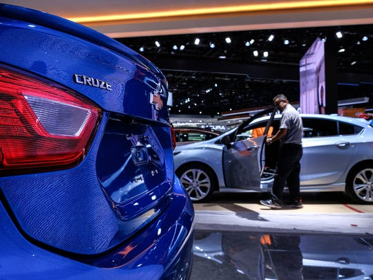 As Ford and Fiat Chrysler shift away from the mid-size car market, General Motors will continue to build cars like the Chevrolet Cruze, seen at the North American International Auto Show at Cobo Center in downtown Detroit, to compete with Toyota, Honda and Nissan.