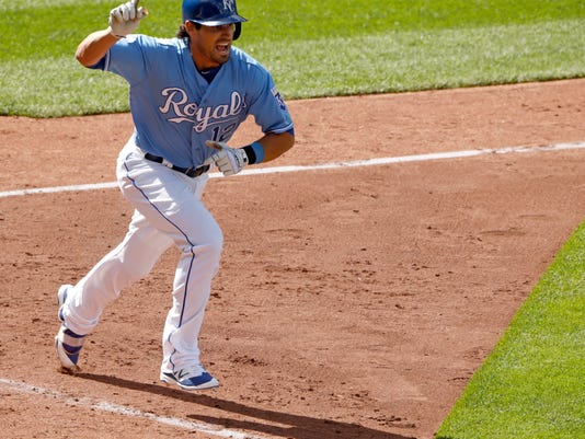 Kansas City Royals' Brett Eibner celebrates after he drove in the game-winning run in the ninth inning of a baseball game against the Chicago White Sox Saturday, May 28, 2016, in Kansas City, Mo. The Royals won 8-7. (AP Photo/Charlie Riedel)