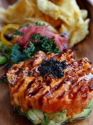 Salmon tartare is served over avocado at Hungry Sumo.