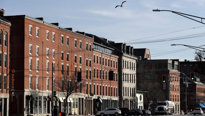 Commercial Street in Portland, Maine, is nearly devoid of pedestrians and traffic, just hours before a stay-at-home order went into effect March 25.