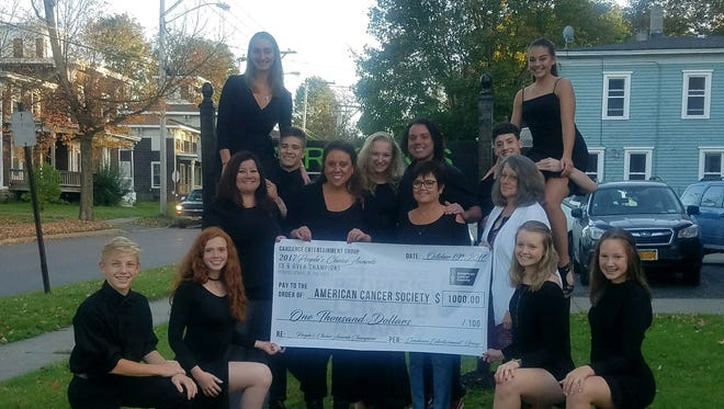 Dancers from the Perkins School of the Arts presented the American Cancer Society with a check for $1,000.