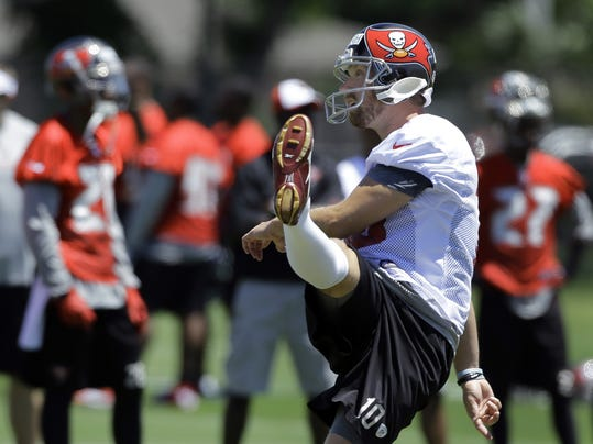 In this April 23, 2014 photo, Tampa Bay Buccaneers' Connor Barth follows through on a kick during a voluntary minicamp NFL football practice in Tampa, Fla. Barth never doubted he'd kick again for the Tampa Bay Buccaneers. The sixth-year pro missed all of last season after rupturing the Achilles tendon in his right foot during a charity basketball game, and he's confident he'll return as good as ever in 2014. (AP Photo)