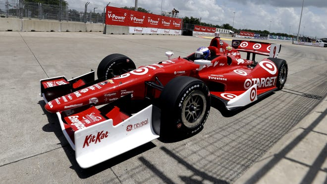 Scott Dixon, of New Zealand, comes out of Turn 2 during a practice session for the IndyCar Grand Prix of Houston auto race Friday, June 27, 2014, in Houston.