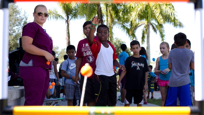Xavian Michel, 9, plays ladder ball at a health fair at Golden Gate Community Center on August 10, 2016. The Healthcare Network of Southwest Florida sponsored the events to help get kids ready for school.