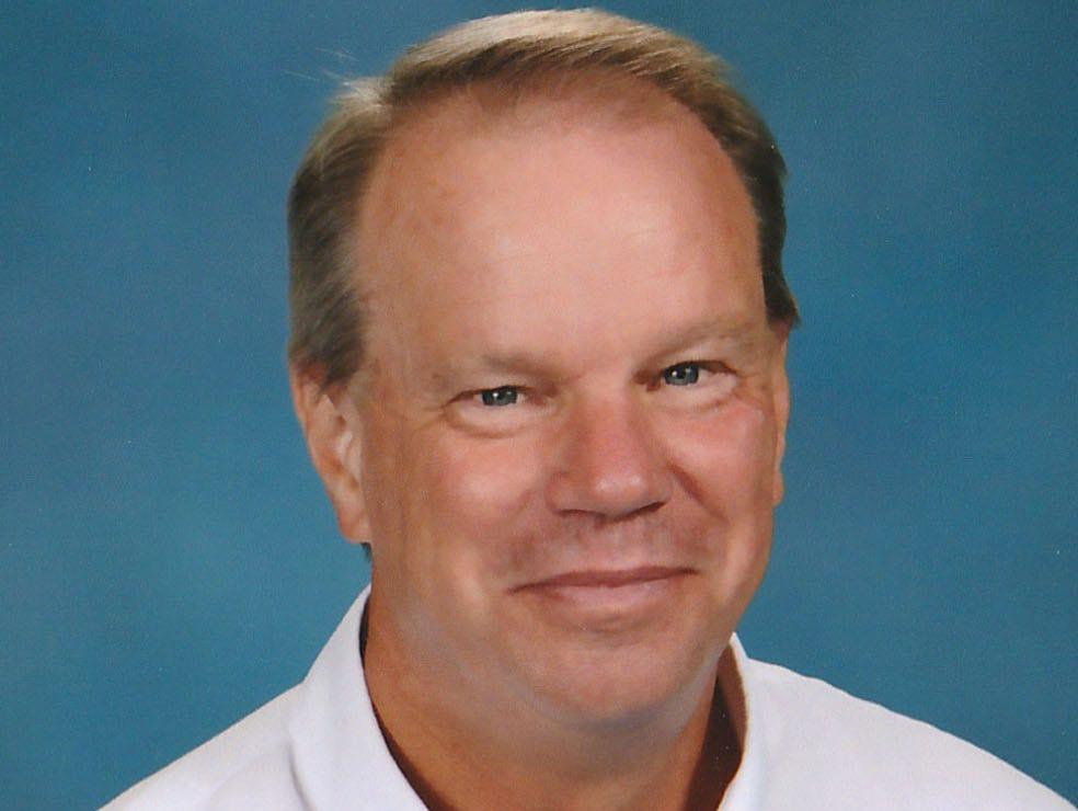 Estero girls golf coach Norman Heyboer