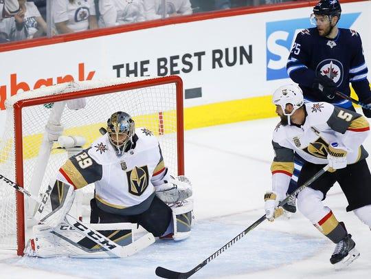 Winnipeg Jets' Patrik Laine, not seen, scores on Vegas