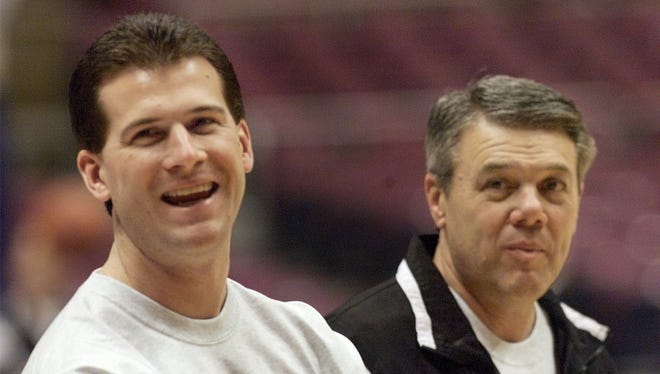 FILE -- Then-Southwest Missouri State head coach Steve Alford, left, accompanied by his father Sam Alford at the Continental Airlines Arena in East Rutherford N.J., March 18 1999.