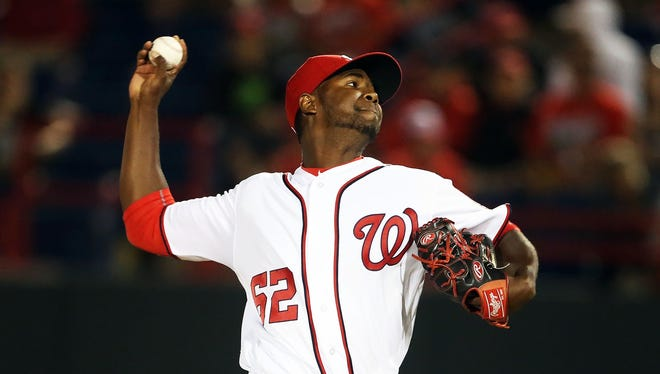 The Reds claimed RHP Abel De Los Santos off of waivers from the Nationals on Tuesday.