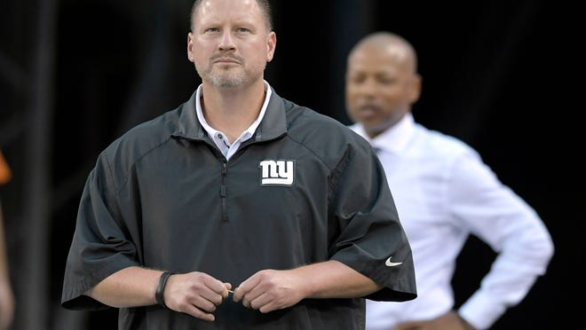 FILE - In this Sept. 18, 2017, file photo, New York Giants coach Ben McAdoo and general manager Jerry Reese, right, look on from the tunnel before an NFL football game against the Detroit Lions in East Rutherford, N.J. With a 1-6 record, the Giants probably are going to miss the playoffs for the fifth time in six seasons, and co-owners John Mara and Steve Tisch have to consider some house cleaning. (AP Photo/Bill Kostroun, File)