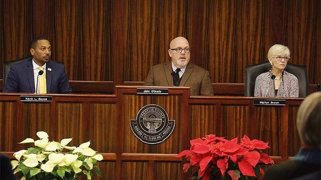 Franklin County Commissioners Kevin L. Boyce, left,  John O'Grady and Marilyn Brown