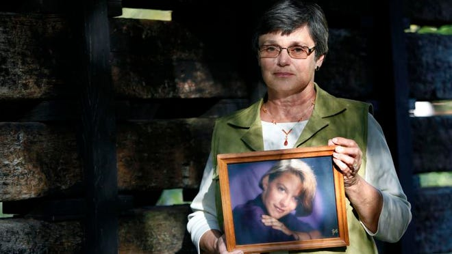 Mary Wegner holds a photograph of her daughter, Laurie Depies, who disappeared in August 1992. USA TODAY WISCONSIN-Network file photo.