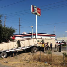 Tractor-trailer crashes off Hammer Lane off-ramp onto Kentucky Fried Chicken restaurant park lot in Stockton. The driver was ejected and killed, Sept. 2, 2014.