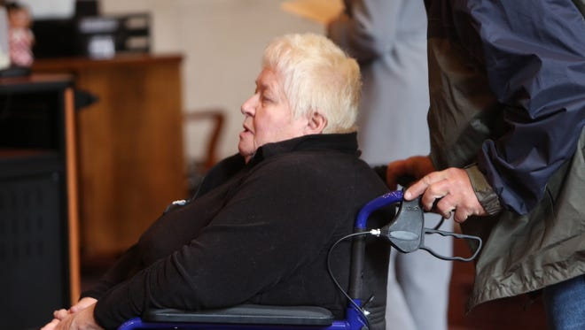 Judith Sidwell being wheeled in front of Hamilton County Common Pleas Judge Patrick Dinkelacker on Thursday.