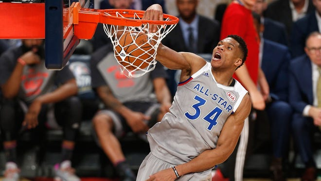Giannis Antetokounmpo rises above the rim at the NBA All-Star Game in New Orleans.