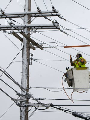 JCP&L lineman Dennis Graziano works on a snow-covered pole in Point Pleasant Beach during a 2009 snowstorm.