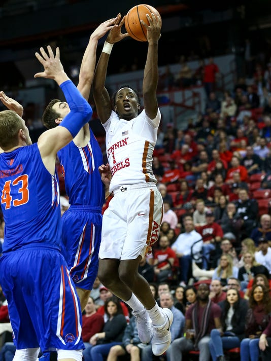UNLV Rebels guard Kris Clyburn (1) shoots against the Boise State Broncos during the second period of an NCAA college basketball game Saturday, Dec. 30, 2017, in Las Vegas. (Richard Brian/Las Vegas Review-Journal via AP)