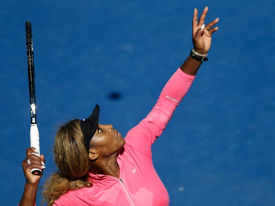 Serena Williams practices serving on a practice court before playing in the opening round of the 2014 U.S. Open tennis tournament, Monday, Aug. 25, 2014, in New York. (AP Photo/Frank Franklin II)